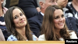 Britain's Catherine, Duchess of Cambridge (R) sits with her sister Pippa Middleton on Centre Court for the men's singles final tennis match at the Wimbledon Tennis Championships in London.