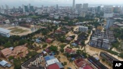 An aerial view shows the flooded George Town city in Penang, Malaysia, Nov. 5, 2017. A northern Malaysian state has been paralyzed by a severe storm that led to two deaths and some 2,000 people evacuated in the worst flooding in years, officials say.