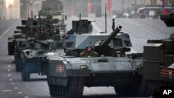 FILE - Russian military vehicles are seen making their way to Red Square in preparation for a Victory Day Parade in Moscow.