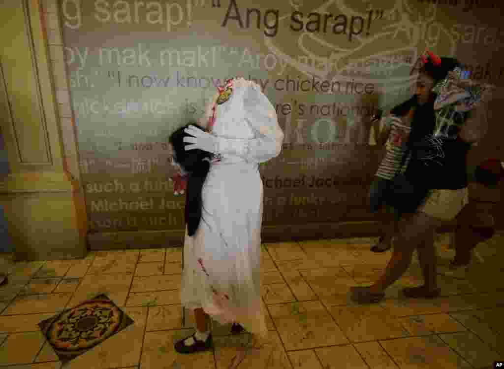 "Children dressed in their most scariest costumes make the rounds of stalls at Manila's Ocean Park, the country's largest oceanarium, for free candies, chocolates and sweets, as they take part in the annual Halloween ""Trick or Treat"" activity ahead of next week's observance of All Saints' Day in Manila, Philippines."