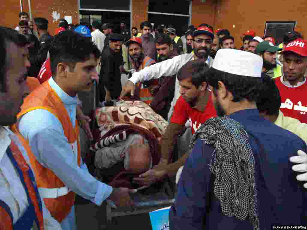 Rescue workers attend to a man injured during the 7.5-magnitude earthquake Monday at the hospital in Peshawar, Pakistan, Oct. 26, 2015.