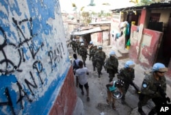 U.N. peacekeepers from Brazil patrol the Cite Soleil slum in Port-au-Prince, Haiti, Feb. 22, 2017. They faced no greater threat than a few barking dogs along some of the same streets where pitched gunbattles between gangs and U.N. peacekeepers used to be a daily occurrence.
