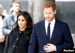 FILE - Britain's Prince Harry and Meghan, Duchess of Sussex in London, Britain March 19, 2019.