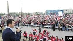 Tổng thống Syria Bashar al-Assad phát biểu trước các ủng hộ viên tại Quảng trường Umayyad ở Damascus, ngày 11/1/2012