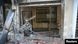 A view shows wreckage after Syrian rebels attacked a security compound at Bab Musalla area in Damascus, June 23, 2013, in this handout photograph released by Syria's national news agency SANA.