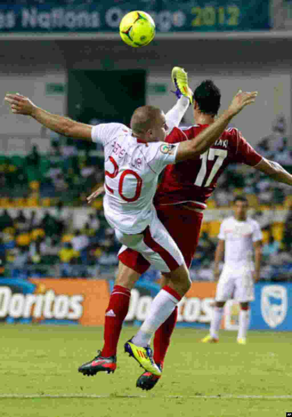 Tunisia's Aymen jumps for the ball with Morocco's Marouane during their African Cup of Nations soccer match in Libreville
