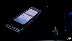 Justin Denison, SVP of Mobile Product Development, talks about the new Samsung Galaxy Fold smartphone during an event Wednesday, Feb. 20, 2019, in San Francisco. (AP Photo/Eric Risberg)