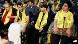 Hezbollah fighters wounded in Syria listen to a speech by their leader, Sheikh Hassan Nasrallah, this month in Beirut.