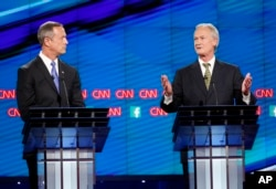 Former Maryland Gov. Martin O'Malley, left, listens as former Rhode Island Gov. Lincoln Chafee speaks during the CNN Democratic presidential debate in Las Vegas, Oct. 13, 2015.