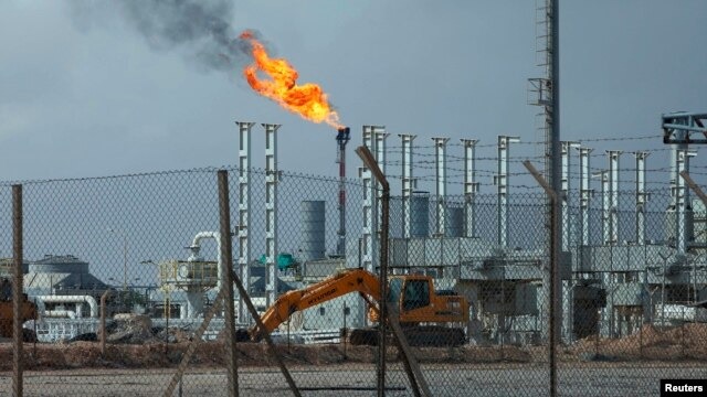 FILE - A view of the Mellitah Oil and Gas complex, 100 kilometrs west of Tripoli, Nov. 7, 2013.