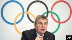 FILE - International Olympic Committee President Thomas Bach is seen speaking during a press conference at IOC headquarters in Lausanne, Switzerland, July 9, 2014.