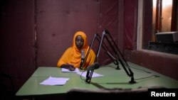 Radio Shabelle presenters reads the news at station headquarters, Mogadishu, Dec. 8, 2012.