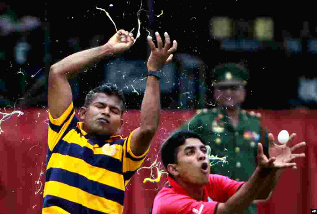 Sri Lankan army officers play a game involving raw eggs as they celebrate Sinhalese and Tamil New Year in Colombo, Sri Lanka, April 10, 2012. (AP)