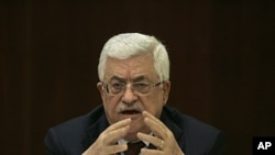 Palestinian President Mahmoud Abbas speaks during a meeting of the Fatah central committee at his headquarters in the West Bank city of Ramallah, January 29, 2012.