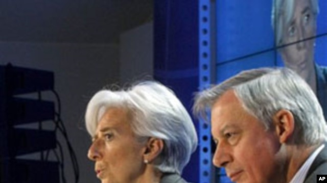 French Finance Minister Christine Lagarde gestures with Central Bank Governor Christian Noyer, right, during a press conference ending the G20 Finance summit at Bercy Finance Ministry in Paris, February 19, 2011
