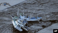 Fishing boats are swept by a tsunami in Oarai City in Ibaragi Prefecture, northeastern Japan March 11, 2011