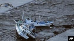 Fishing boats are swept by a tsunami in Oarai City in Ibaragi Prefecture, northeastern Japan March 11, 2011.