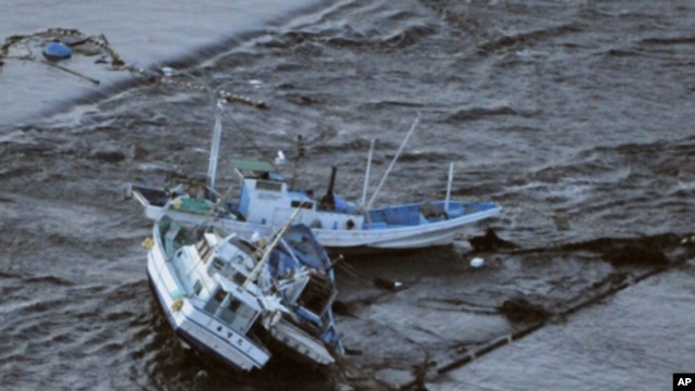 Fishing boats are swept by a tsunami in Oarai City in Ibaragi Prefecture, northeastern Japan March 11, 2011.