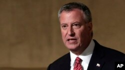 FILE - New York Mayor Bill de Blasio supports access to the city's single-sex public restrooms and other facilities based on an individual's gender identity. He's shown in 2014.