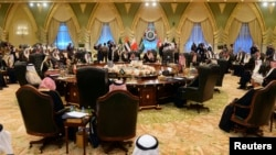 Heads of States of the Gulf Cooperation Council sit at a round table in Bayan Palace for the opening session of the 34th GCC Summit hosted by Kuwait, Dec. 10, 2013.
