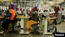 FILE - Workers sew clothes inside the Indochine Apparel textile factory in Hawassa Industrial Park in Southern Nations, Nationalities and Peoples region, Ethiopia November 17, 2017. (REUTERS/Tiksa Negeri/File Photo)