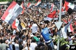 Des partisans du président Assad à Damas