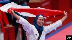Defia Rosmaniar, atelt taekwondo Indonesia, setelah berhasil meraih emas pertama bagi Indonesia di Asian Games 2018.