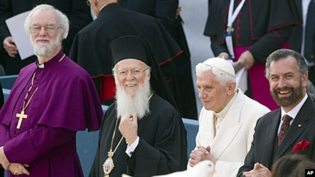 From left, Canterbury Archbishop Rowan Douglas Williams, Ecumenical Patriarch Bartholomew I, Pope Benedict XVI  and Rabbi David Rosen look on as a person holds a dove released during a peace meeting in front of the St. Francis Basilica in Assisi, central