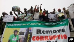 FILE - People protest following the removal of fuel subsidy by the government in Lagos, Nigeria, Jan. 9, 2012.