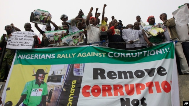 People protest following the removal of  fuel subsidy by the Government in Lagos ,Nigeria, Jan. 9, 2012. Labor unions began a paralyzing national strike in oil-rich Nigeria, angered by soaring fuel prices and decades of engrained government corruption in