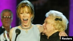 "FILE - Actresses Mary Tyler Moore, left, and Rose Marie, stars of the television show ""The Dick Van Dyke Show,"" accept the Legend Award for their classic series at the first annual TV Land Awards, which were taped in Hollywood March 2, 2003."