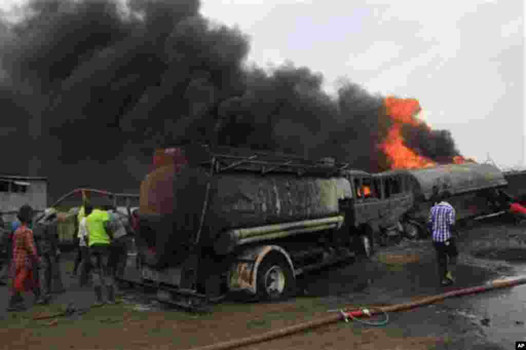 Firefighters try to contain a fire at an informal diesel fuel depot in Lagos, Nigeria on Thursday, Feb. 16, 2012.