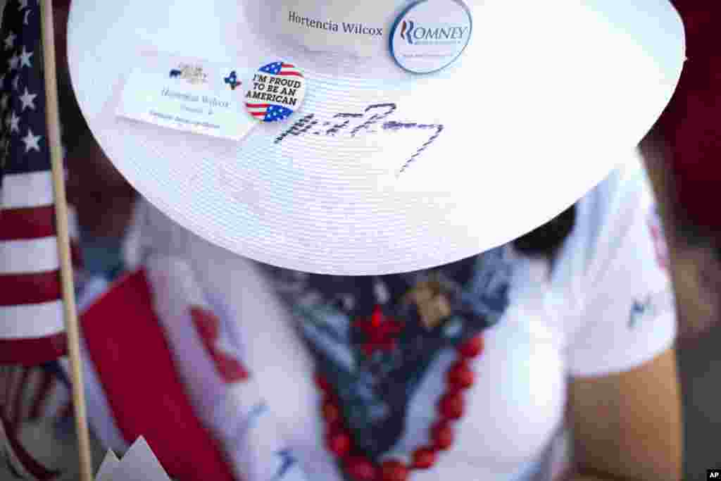 Hortencia Wilcox of Allen, Texas wears a hat signed by Republican presidential candidate, former Massachusetts Gov. Mitt Romney while waiting in line at a campaign stop in Fort Worth, Texas, June 5, 2012. (AP)