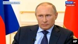 Tổng thống Nga Vladimir Putin trả lời các câu hỏi liên quan tới tình hình Ukraina tại Moscow, ngày 4/3/2014.