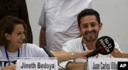 FILE - Jineth Bedoya, left, and Juan Carlos Villamizar, victims of the Colombian armed conflict, smile during a press conference in Havana, Cuba, Nov. 2, 2014.