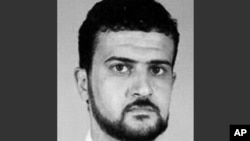 FILE - This file image from the FBI website shows Anas al-Libi, an al-Qaeda leader connected to the 1998 embassy bombings in eastern Africa.