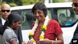 Ethnic Tamil girl presents floral garland to welcome U.N. High Commissioner for Human Rights, Navi Pillay, Kilinochchi, Sri Lanka, Aug. 27, 2013.