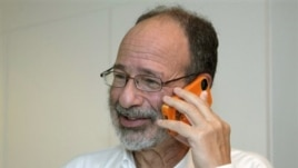 Alvin Roth takes a phone call after being awarded the Nobel economics prize, at his home in Menlo Park, California, October 15, 2012.