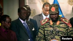 South Sudan's President Salva Kiir (R) addresses a news conference at the Presidential Palace in capital Juba December 16, 2013, a day after fighting erupted in the capital. Government officials said the unrest was triggered by a failed coup, a premise that has been widely rejected by the international community, and a report by an African Union Commission of Inquiry, released on Oct. 27, 2015.