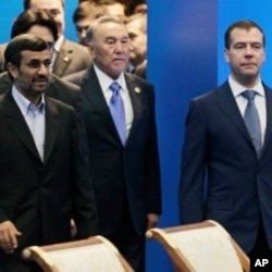 Front row from left, Iranian President Ahmadinejad, Kazakhstan's President Nazarbayev and Russian President Medvedev walk after a meeting of the Shanghai Cooperation Organization in Kazakhstan's capital Astana, June 15, 2011