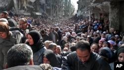 مهاجرین فلسطینی در کمپ یرموک - در نزدیکی دمشق، سوریه