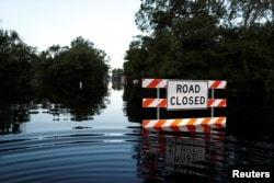 State Road 76 is blocked by flood waters in the aftermath of Hurricane Florence in Fair Bluff, North Carolina, U.S., Sept. 18, 2018.