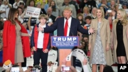 Republican presidential candidate Donald Trump, middle, speaks near his wife, Melania, left, son Baron, daughter Ivanka, second from right, and daughter Tiffany during a campaign event at the Myrtle Beach Convention Center on Nov. 24, 2015, in Myrtle Beac
