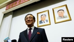 North Korean Ambassador to China Ji Jae Ryong arrives for a news conference in Beijing, Jan. 29, 2014.