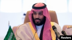 FILE - Saudi Crown Prince Mohammed bin Salman speaks during the meeting of Islamic Military Counter Terrorism Coalition defense ministers in Riyadh, Nov. 26, 2017.