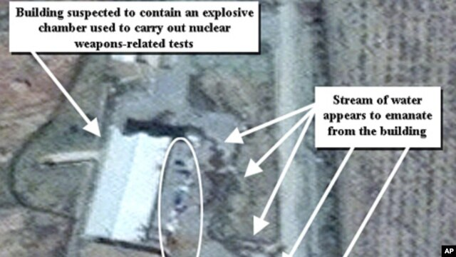 April 9, 2012 photo provided by the Institute for Science and International Security, shows suspected cleanup activities at a building alleged to contain a high explosive chamber used for nuclear weapon related tests in the Parchin military complex in Ira