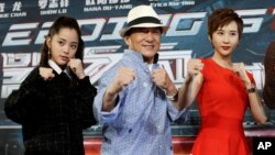 Actor Jackie Chan (C) poses with Nana Ou-Yang (L) and Erica Xia-Hou at the announcement of the beginning of production for the sci-fi action film 'Bleeding Steel', billed by producers as the biggest budget Chinese film ever shot in Australia, in Sydney, Australia July 28, 2016.