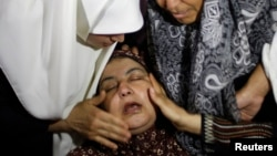 Majka Ibrahima al-Davavse, desetogodišnjaka koji je stradao u izraelskom vazdušnom napadu na dečakovoj sahrani