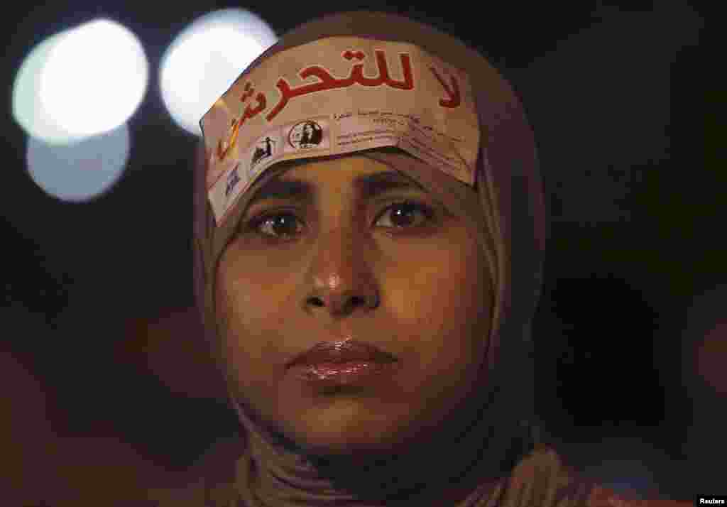 """A woman wearing a sign on her head that reads """"No Harassment"""" takes part in a protest against Egypt's President Mohamed Mursi and the Muslim Brotherhood and in support of women rights in Cairo October 4, 2012."""