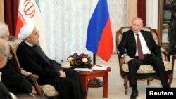Президент Росії Володимир Путін і його іранський колега Хассан Роугані, 13 вересня 2013 р.